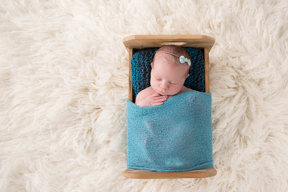 newborn baby in bed victoria